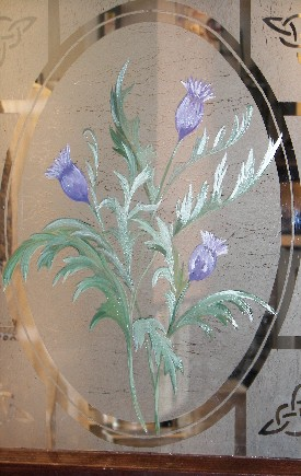 Stained glass thistle at Braveheart Highland Pub in Hellertown, PA as seen in American Public House Review